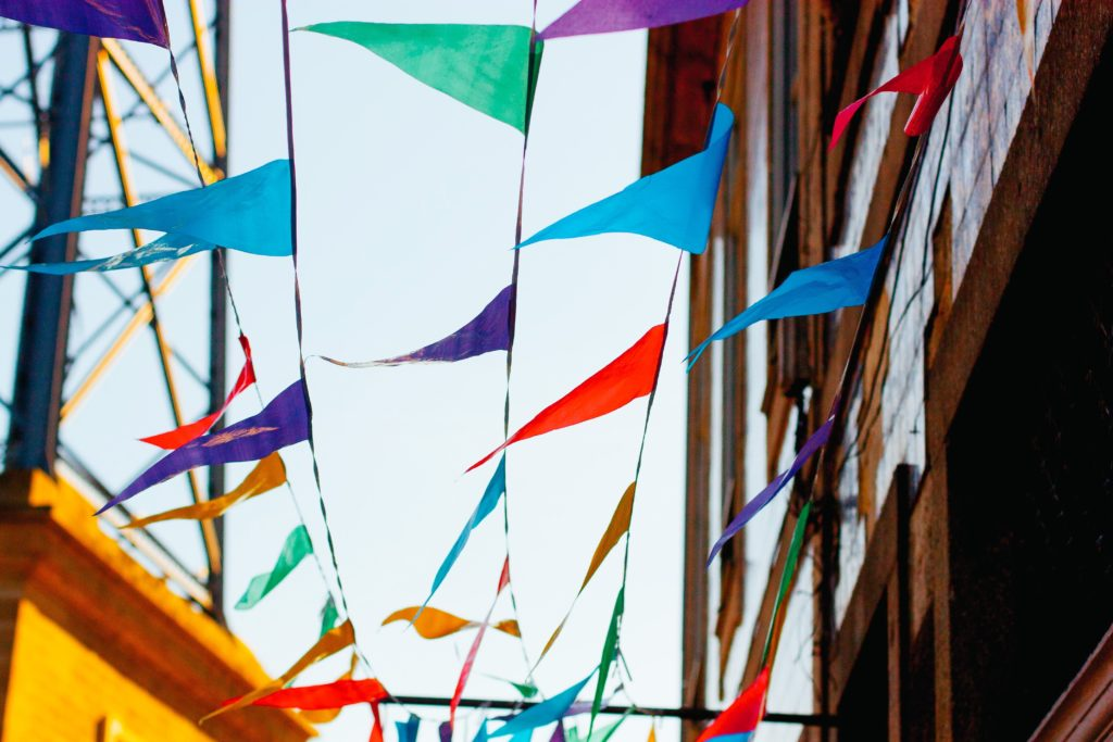 Flags blowing in the wind representing mindfulness, one of the core skills of Dialectical Behavioral Therapy (DBT)
